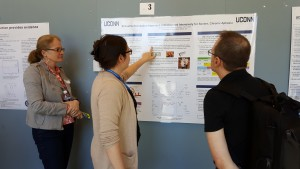 "A graduate student presents her poster ""Schuell's Stimulation Approach Administered Intensively for Severe, Chronic Aphasia"" under the watchful eye of her advisor."