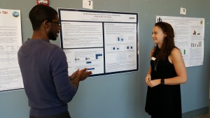 A graduate student discusses research with an undergraduate student at the 2016 UConn Language Fest.