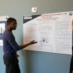 "A graduate student presents their poster ""Examining Narrative Discourse Deficits in TBI Using Coh-metrix"" at the 2016 UConn Language Fest."