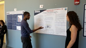 """A graduate student presents their poster """"Examining Narrative Discourse Deficits in TBI Using Coh-metrix"""" at the 2016 UConn Language Fest."""