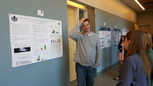 A graduate student contemplates an answer after attendees ask him a question about his presentation at the 2016 UConn Language Fest.