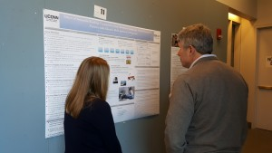 A student presents their poster to Dr. Coehlo at the 2016 UConn Language Fest.