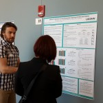 A student presents his poster at the 2016 UConn Language Fest.