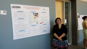 "A student poses with her poster ""Use of Turkish verbal morphology by TD children and children with LI"" at the 2016 UConn Language Fest."