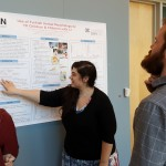 "A student presents her poster ""Use of Turkish Verbal morphology by TD children & children with LI"" at the 2016 UConn Language Fest."