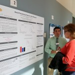 "A graduate student presents his poster ""Neural Processing of Sound in Adult Bilinguals"" to attendees at the 2016 UConn Language Fest."