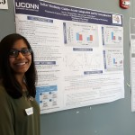 "A student poses with her poster ""Talker similiarity guides accept adaptation and its generalization"" at the 2016 UConn Language Fest."